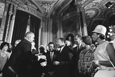 President Lyndon B. Johnson, Martin Luther King, Jr., and Rosa Parks at the signing of the Voting Rights Act on August 6, 1965 Photo: President Lyndon B. Johnson, Martin Luther King, Jr., and Rosa Parks at the signing of the Voting Rights Act on August 6, 1965. Photo: Yoichi Okamoto/Lyndon Baines Johnson Library and Museum.